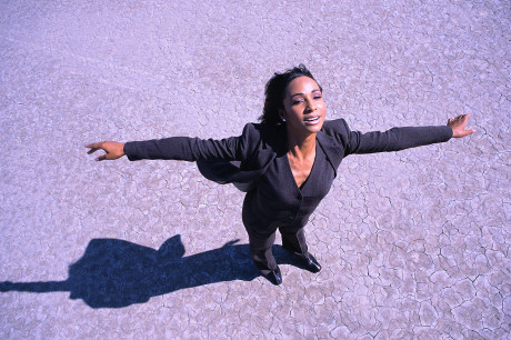 Businesswoman with Arms Outstretched