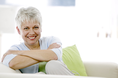 Cheerful Woman on a Sofa