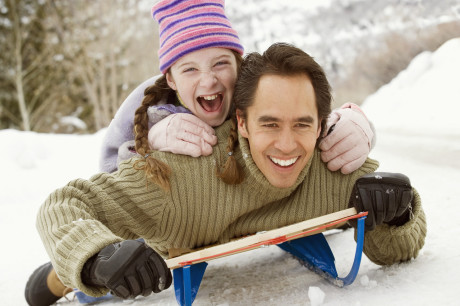 Father and Daughter Sledding